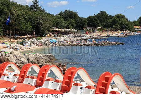 Porec, Croatia - June 20, 2011: People Enjoy The Beach In Porec, Croatia. In 2011 11.2 Million Touri