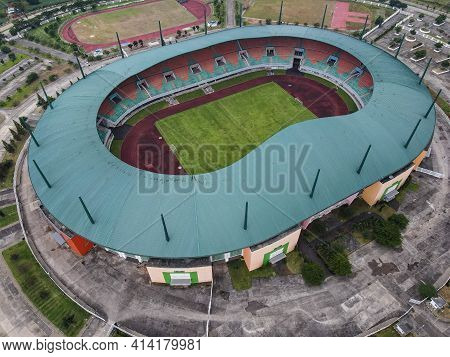 Aerial View Of The Largest Stadium Of Pakansari Stadium From Drone. Indonesia. With Noise Cloud When