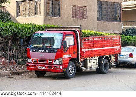 Giza, Egypt - January 26, 2021: Red Cargo Truck Chevrolet Jumbo In The City Street.