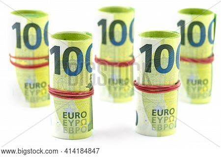 Macro Shot Of The European Union 100 Euro Banknote, A Few Bills Rolled Up In A Rubber Band, Isolated