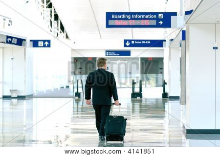 Business Man Walking Through The Airport