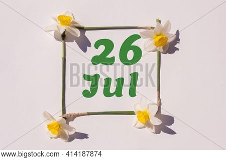 July 26th. Day 26 Of The Month, Calendar Date. Frame From Flowers Of A Narcissus On A Light Backgrou