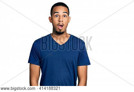 Young african american man wearing casual t shirt afraid and shocked with surprise expression, fear and excited face.
