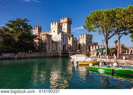 Sirmione, Italy - Aug 7, 2016: Entrance to Scaligero Castle, one of Italy's best preserved castles and most visited tourist attractions in Italy