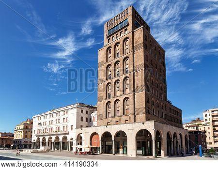 Brescia, Italy - Aug 7, 2016: Art Deco Torrione INA, the first skyscraper in Italy at the  Piazza della Vittoria (Victory square)