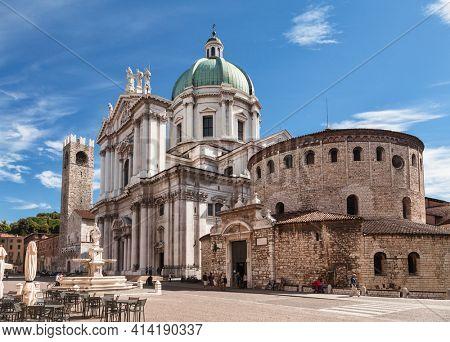 Brescia, Italy - Aug 7, 2016: Piazza Paolo VI with Old Cathedral (Duomo Vecchio) or La Rotonda and New Cathedral (Duomo Nuovo)