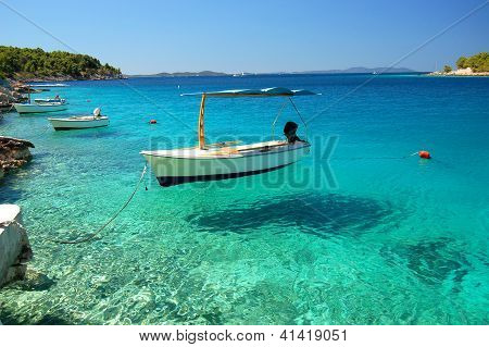 Boat in a quiet bay on Brac island in Croatia