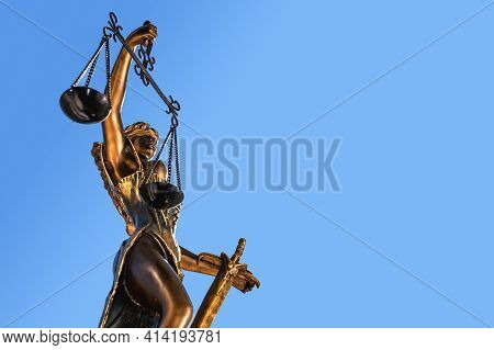 Statue Of Lady Justice With Scales Of Justice. Legal Law Concept. On A Sky Background