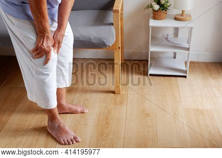 Elderly Asian Woman Holding A Leg That Is Painful From Varicose Veins Or From Osteoarthritis, Variou