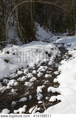 Winter Mountain Landscape: Winter Forest In The Snow, Mountain River With Banks Covered With Snow An