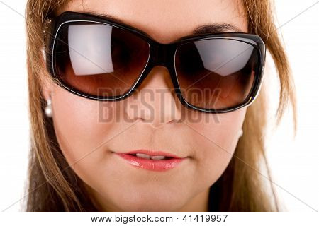 Close-up Portrait Of Woman In Sunglasses