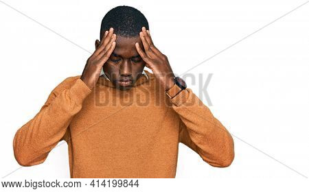 Young african american man wearing casual clothes suffering from headache desperate and stressed because pain and migraine. hands on head.