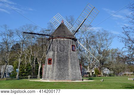EASTHAM, MASSACHUSETTS - OCTOBER 18, 2011: Eastham Windmill. The Eastham Windmill, is the oldest windmill on Cape Cod. It was added to the National Register of Historic Places in 1999.