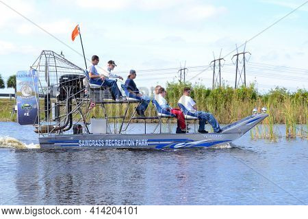 WESTON, FLORIDA - DECEMBER 27, 2012:  Tourists on an airboat at Sawgrass Recreation Park in the Florida Everglades.