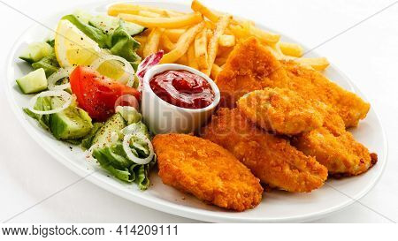 Tasty And Delicious Nuggets Fast Food French Fries Finger Chips Green Salad And Vegetable Fresh And