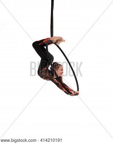 Aerial Teen Acrobat Performing Trick On Hula Hoop