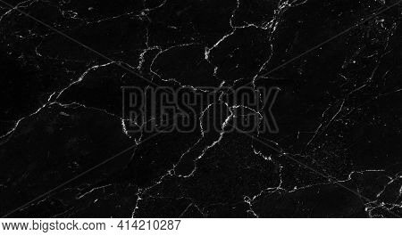 Closeup Photo Background Of Natural Marble Pattern. Black Marble Stone With Texture Of White Veins,