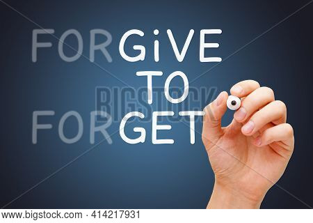 Hand Writing With Marker Forgive To Forget, Give To Get Forgiveness Concept.