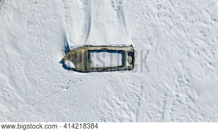 Top View Of Fishing Boats On A Snowy Beach, Winter