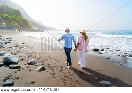 Lifestyle With Caucasian Senior Couple Walking On Beach, Happy In Love Romantic And Relax Time, Tour