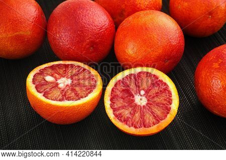 Heap Of Blood Oranges. Low Key. Close Up.