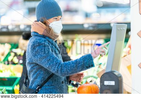 Weighing Vegetables In A Store On A Digital Scale