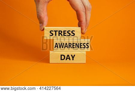 Stress Awareness Day Symbol. Wooden Blocks With Words 'stress Awareness Day'. Beautiful Orange Backg