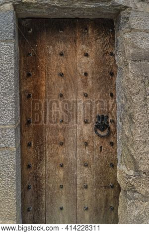 Vintage Wooden Door With Stone Frame, Cast Iron, Ring Shaped, Doorhandle And Iron Studs, Ross Castle