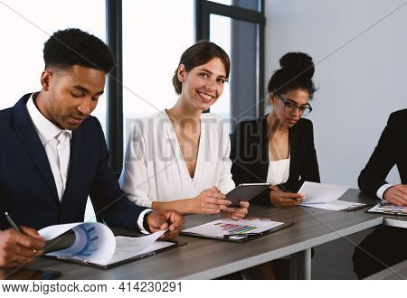 Team Of People Work Together In Office With Company Statistics. Concept Of Teamwork And Partnership.