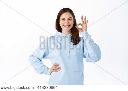 Wow Really Not Bad, Good Choice. Impressed Good-looking Modern 20s Woman In Blue Hoodie, Nod Accepti
