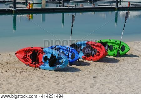 Colorful Multi Colored Kayaks Lying Orderly On Sandy Beach At Sport Recreation Area.beach Family Act