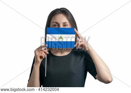 Happy Young White Woman Holding Flag Nicaragua Flag And Covers Her Face With It Isolated On A White