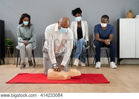 Cpr First Aid Training With Paramedic Instructor In Face Mask