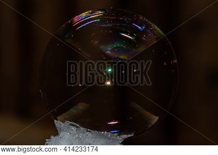 Close Up Of Round Fragile Soap Bubble With Rainbow Colours.