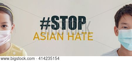 Asian Girl And Preteen Teen Boy Wearing Medical Face Masks With Stop Asian Hate Message