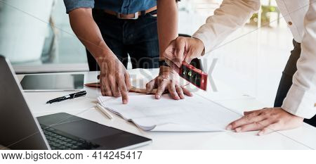 Two Architect Man Working With Laptop And Blueprints For Architectural Plan, Engineer Sketching A Co