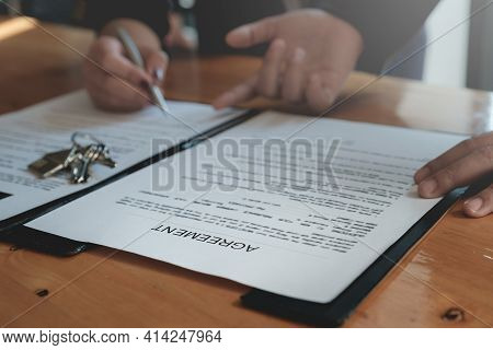 Businessman Puts Signature On Contract At Business Meeting And Sign In Contract With Business Partne