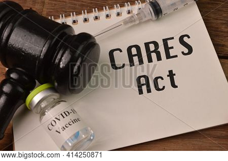 Judge Gavel, Syringe, Covid-19 Vaccine And Notebook Written With Cares Act Stands For The Coronaviru