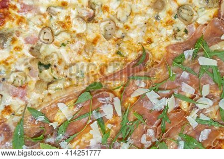 Close Up Two Flavors Italian Pizza On Table For Background