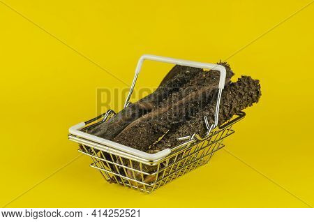 Shopping Basket With Dog Treats On A Yellow Background. Natural Dried Chew Treats For Pets. Sticks O
