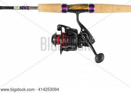 Fishing Rod Spinning With The Line Close-up. Fishing Rod And Reel Isolated On White Background. Fish
