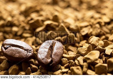Beans Of Natural Roasted Coffee Close-up Lie On The Granules Of Instant Coffee. Ingredients Of A Fra