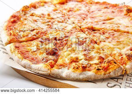 Italian Pizza - Traditional Four Cheese Pizza or Quattro Formaggio Pizza. Four Cheese: Mozzarella, Parmesan, Brie and Ricotta. Isolated on White Background