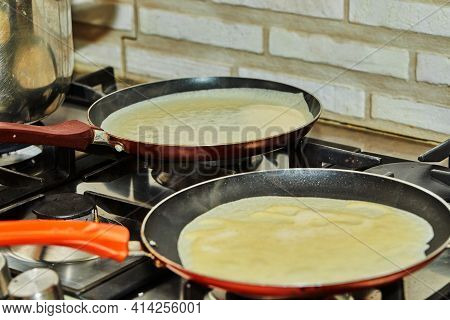 Pancakes Are Fried In Pans On A Gas Oven. Step By Step Recipe.