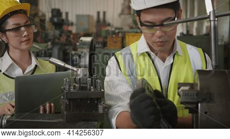 Asian Professional Mechanical Engineer Woman And Operation Man Wearing Uniform Hardhat And Goggles S