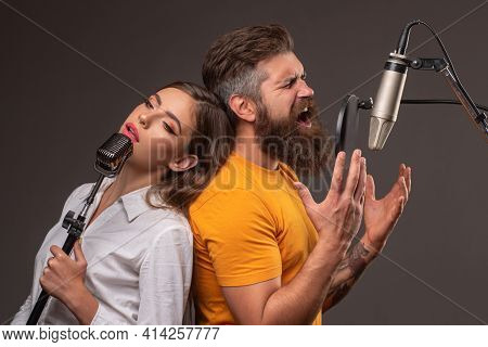 Singer Couple Singing Rock. Sound Producer Recording Song In A Music Studio. Excited Duet Karaoke