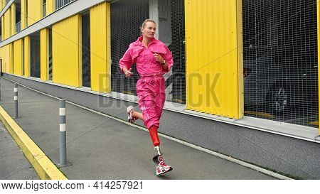 All Sports For All People. Image Of Young Disabled Sports Woman With Bionic Leg Running Outdoors. Di