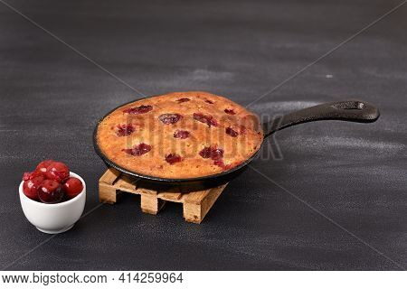 Sour Cherry Cake In A Pan On A Wooden Trivet.
