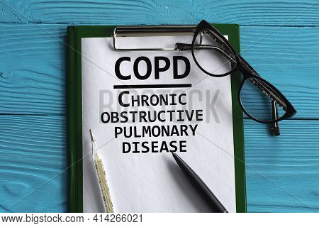 Copd (chronic Obstructive Pulmonary Disease) - Acronym In A Notepad On A Blue Background With A Pen,
