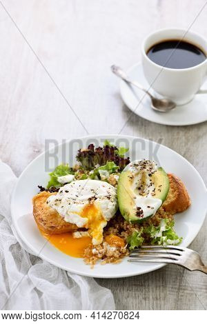 A Healthy And Balanced Breakfast Plate. Benedict's Egg Spreads On A Toasted Toast With Half An Avoca